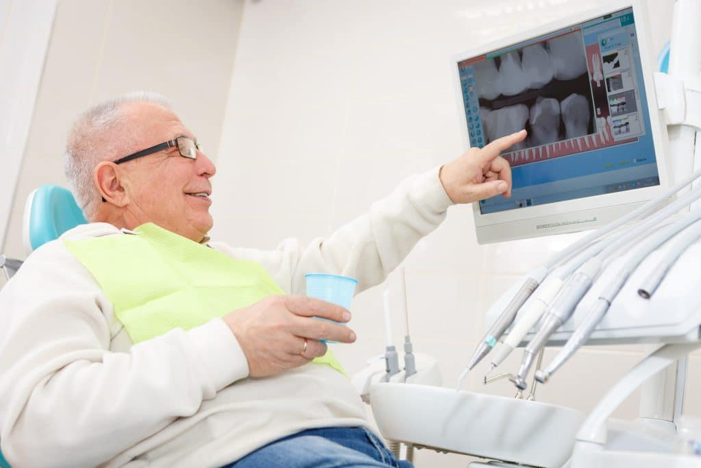 citrus heights dental male dental patient looking at films